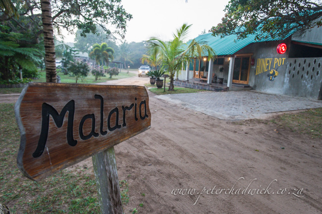 malaria sign by wildlife and conservation photographer Peter Chadwick