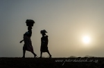 Mozambique ladies in the mist by wildlife and conservation photographer Peter Chadwick.jpg