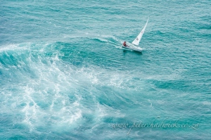 Lone yachtsman at sea by wildlife and conservation photographer Peter Chadwick.