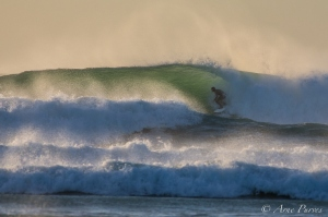 A Surfer Tucks Into A Cold Atlantic Barrel