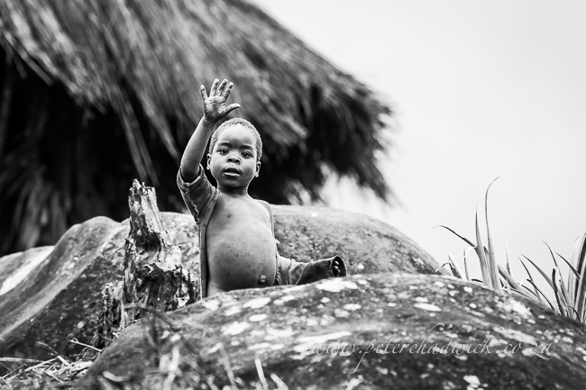 Mozambican child waving by wildlife and cosnervation photographer Peter Chadwick