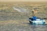 Throw-net fisher by wildlife and conservation photographer Peter Chadwick.jpg